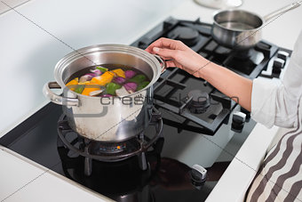 Close up on woman cooking healthy vegetables