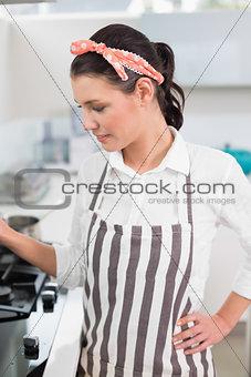 Focused gorgeous cook posing