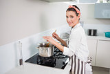Cheerful pretty cook mixing vegetables