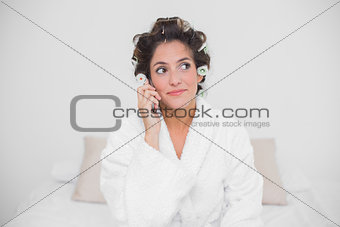 Thoughtful natural brunette phoning