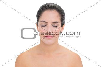Calm bare brunette closing her eyes