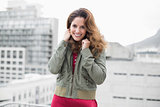 Smiling gorgeous brunette in winter fashion looking at camera