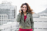 Happy gorgeous brunette in winter fashion phoning
