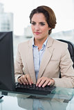 Calm businesswoman looking at computer