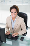 Cheerful businesswoman looking at camera
