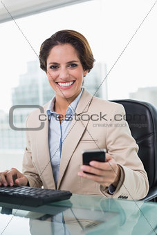 Attractive businesswoman smiling at camera