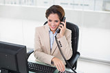 Smiling businesswoman using phone
