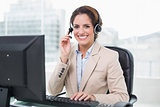 Smiling businesswoman holding headset