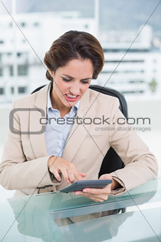 Angry businesswoman using calculator