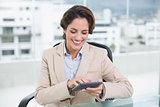 Cheerful businesswoman using calculator