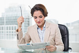 Content businesswoman reading newspaper