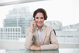 Smiling businesswoman phoning with smartphone