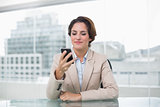 Businesswoman smiling at her smartphone