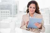 Beautiful smiling businesswoman using tablet