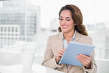Beautiful happy businesswoman using tablet