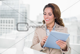 Beautiful happy businesswoman using tablet