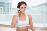 Sporty pleased brunette phoning