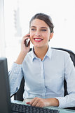 Content classy brown haired businesswoman making a phone call