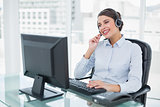 Joyful classy brown haired operator answering a call