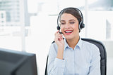 Attractive classy brown haired operator answering a call