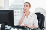 Thoughtful businesswoman sitting at desk