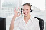 Happy call centre agent looking at camera giving ok sign