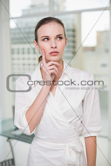 Thoughtful businesswoman standing