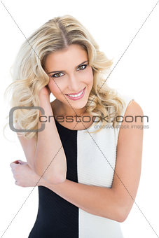 Smiling blonde model looking at camera