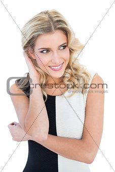 Smiling blonde model looking away