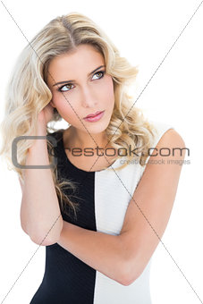 Thoughtful blonde model looking up