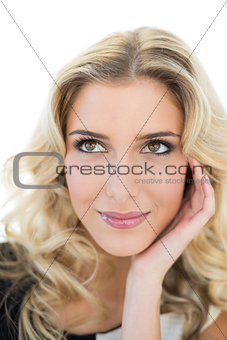 Happy blonde model looking up