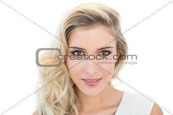 Smiling beautiful blonde model looking at camera
