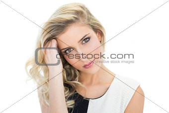 Thoughtful smiling blonde model looking at camera