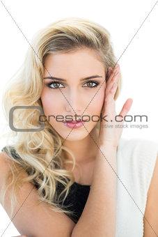 Slightly smiling blonde model looking at camera