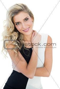 Smiling blonde model holding her neck