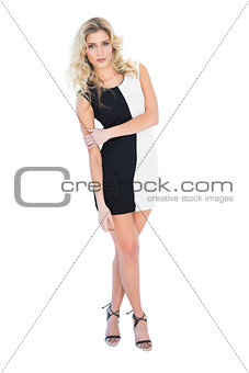 Calm attractive blonde model looking at camera