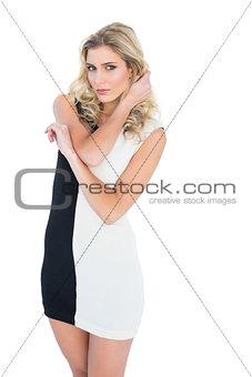 Beautiful calm blonde model looking at camera