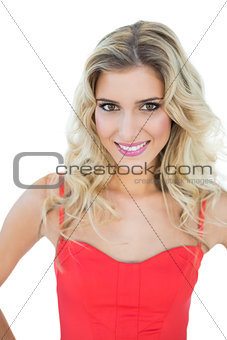 Bright smiling blonde model looking at camera