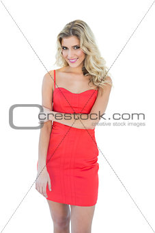 Gleeful blonde model looking at camera