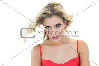 Beautiful serious blonde model looking at camera
