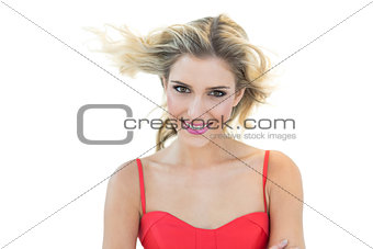 Charming smiling blonde model looking at camera
