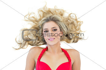 Attractive blonde model wearing red bikini looking at camera