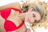 Beautiful blonde model wearing red bikini looking away