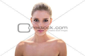 Beautiful nude blonde model looking at camera