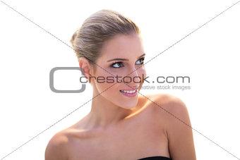 Glowing smiling blonde model looking up