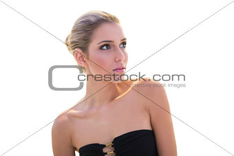 Calm content blonde model looking up