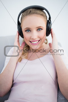 Casual attractive blonde listening to music