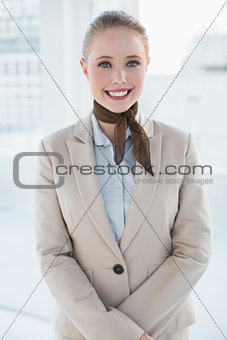 Blonde cheerful businesswoman looking at camera