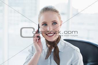 Blonde content businesswoman phoning
