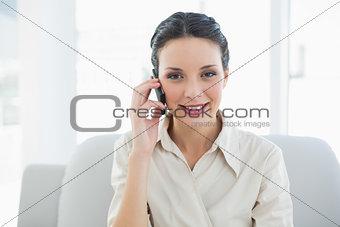 Charming stylish brunette businesswoman making a phone call